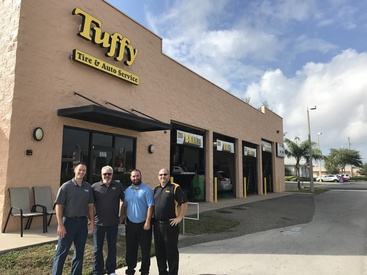 Pictured in the photo from left to right (Barry Unrast – T.A.C. Director of Marketing, Craig Gantner – Tuffy Franchisee, Jay Fernandez – Tuffy Franchisee, and Scott Linde – T.A.C District Manager).